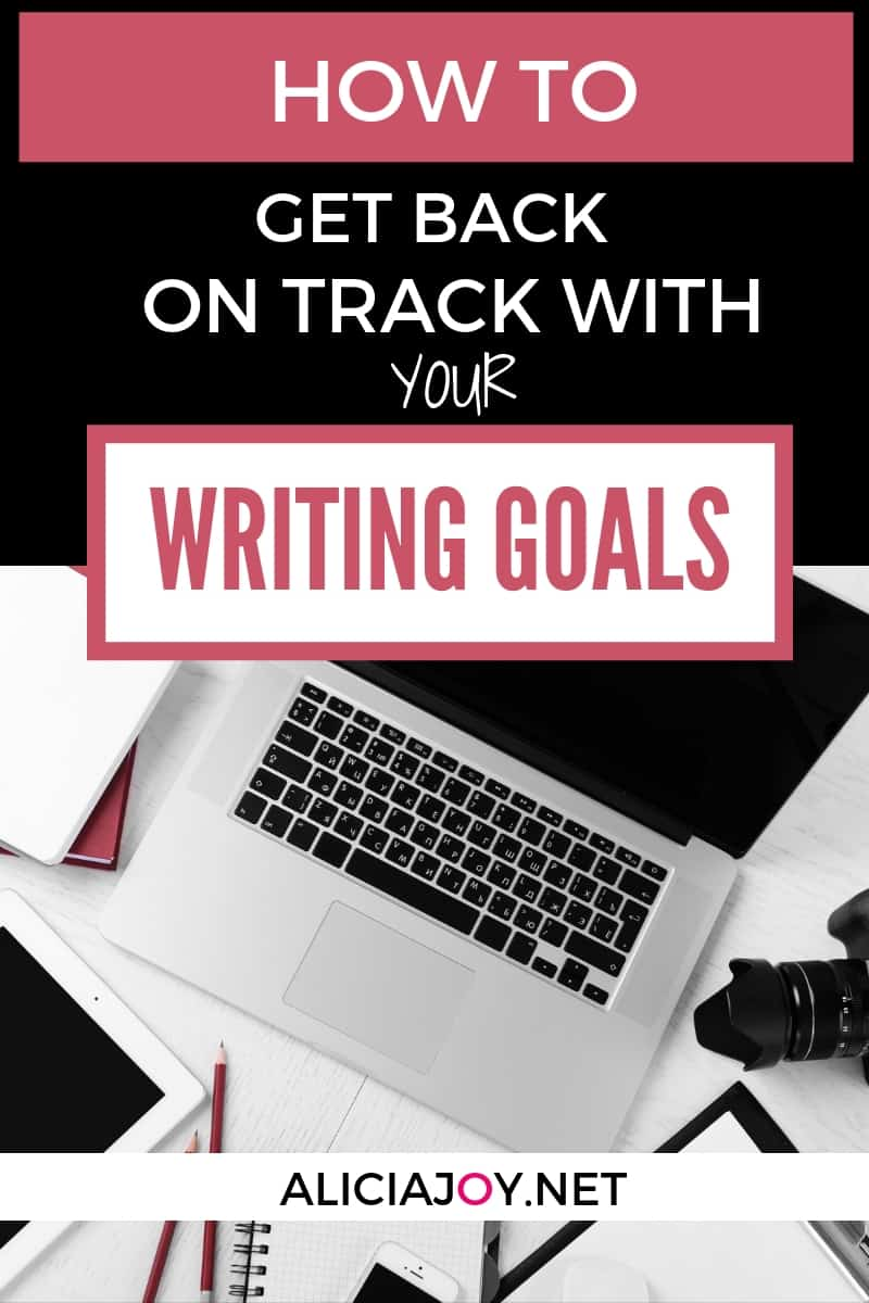 image of open laptop with writing accessories surrounding on white surface with text box above with the words: How to get back on track with your writing goals