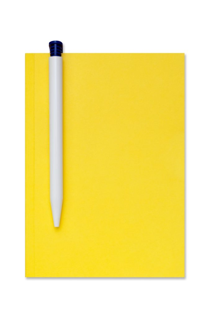 image of notebook and pen in blog post 9 types of stories to add to your blog